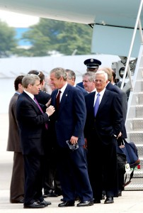 Met Council CEO William E. Rapfogel [left] greeting President Bush as he disembarks Air Force One.
