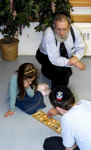 Rabbi Shaya Gansbourg with his children Rashi (l.) and Yossel at the Chabad of Harlem, a synagogue and community center at 437 Manhattan Ave.