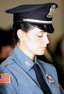 Baile Glauber of Ramapo bows her head for the invocation during the graduation ceremony from the Police Academy at the Rockland Fire Training Center in Ramapo on June 13. (Angela Gaul/The Journal News)