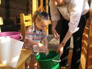 Rabbi Horovitz with his 3 year old son in their new school. Photo Credit COL