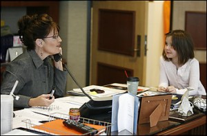 Alaska Gov. Sarah Palin in her office with one of her five children.