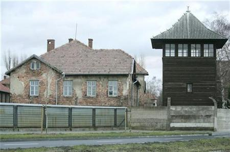 One of the barracks and a watch tower are seen in the former Nazi death camp Auschwitz in Oswiecim, poland, January 12, 2007.