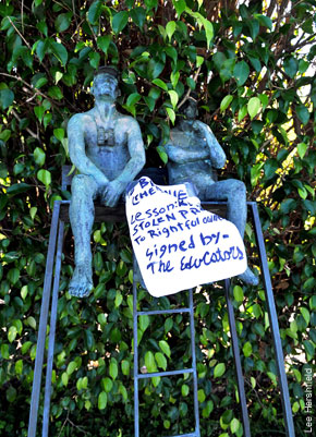"TO THIEF, FROM THIEF: Bernie Madoff's lifeguard statue bears a note from the swiper: ""Return stolen property to rightful owners."""