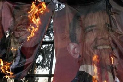 Hardline demonstrators burn posters of U.S. President-elect Barack Obama, during a demonstration in support of the people of Gaza, in front of the Swiss Embassy in Tehran January 13, 2009.