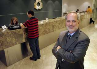 Leonard Abess just gave away $60 million to his employees after selling the bank to a Spanish bank. The bonuses came to tens and hundreds of thousands of dollars. This is Leonard Abess, CEO in the lobby of the bank.