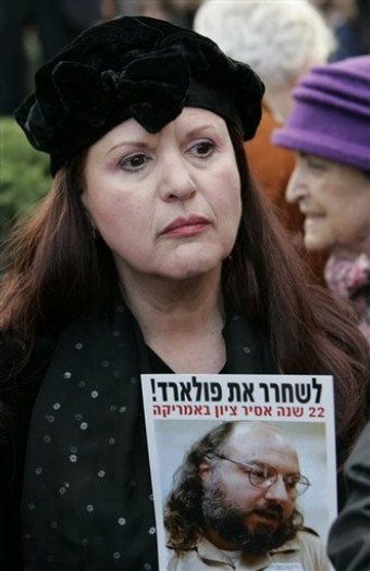 Esther Pollard, left, wife of imprisoned Jonathan Pollard, holds a picture of him during a protest in Jerusalem, demanding his release, Monday Jan. 7, 2008