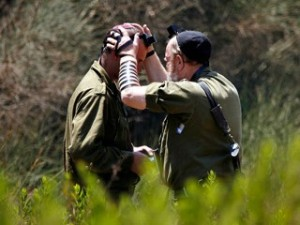 In this file photo, an Israeli army rabbi blesses a soldier who just returned from Lebanon to north of Israel near the Israeli-Lebanon border August 11, 2006.