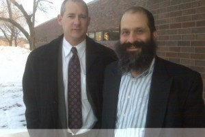 Shortly after posting bail in Iowa Jan. 28, 2009, Sholom Rubashkin, right, stands with one of his lawyers