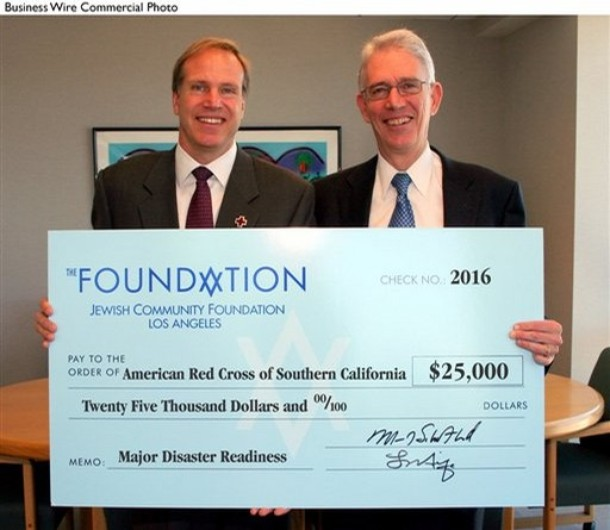 Marvin I. Schotland (right), president and chief executive officer, Jewish Community Foundation of Los Angeles, presents a $25,000 check to Paul Schulz, CEO, American Red Cross of Greater Los Angeles (AP file photo)