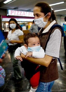 A woman and her baby wear face masks as prevention against the swine flu virus in Mexico City on Fri. April 24, 2009. The mayor canceled all public events for 10 days amid fears of a global pandemic.