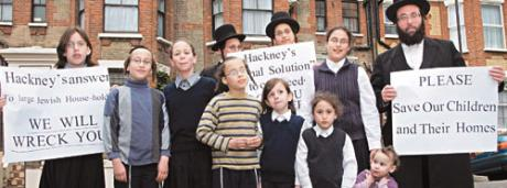 Isaac Liebowitz (far right) and his 10 nephews and nieces in front of the disputed loft extension