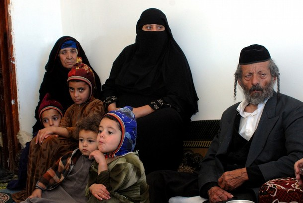 Yussuf (R), the father of a Yemeni Jew Masha Yaeish al-Nahari killed earlier this month, sits at his home with his daughter (C), wife (L) and his sons children in Raydah, 70 kms north of the capital Sanaa