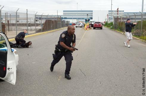 "Five French tourists were taken on a hair-raising, seven-mile ""ride from hell"" yesterday when an illegal van picked up the unsuspecting passengers at JFK Airport and raced through two boroughs to try to shake cops, authorities said. Here, NYPD and Port Authority officers draw their weapons during the confrontation."