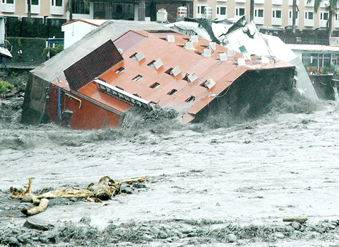 The collapsed Jinshuai Hotel lies in the Jhihben River in Jhihben Township, Taitung County