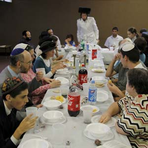 Bar mitzvah is a time for celebration, and Orthodox Jewish congregations celebrate with gusto. Despite public conceptions of Orthodoxy as staid and reserved, many of these traditions emphasize enjoyment of all of Gods bounty.  Photo by Christine Lockerby