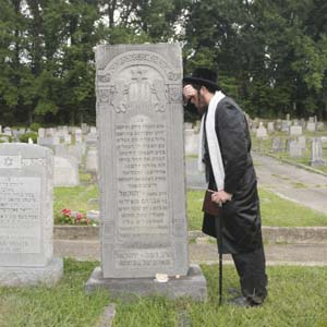 Rabbi Joseph Kolakowski making the pilgrimage to the grave of another rabbi At the Sir Moses Montefiore Cemetery in Richmonds East End. Photo by Scott Elmquist