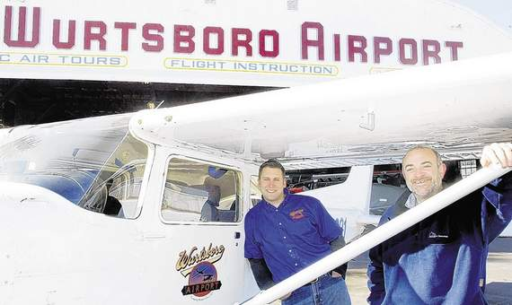 Shalom Lamm, front, owner of Wurtsboro Airport, and Dan Depew, airport manager, have big plans for the airport's future. Times Herald-Record/MICHELE HASKELL