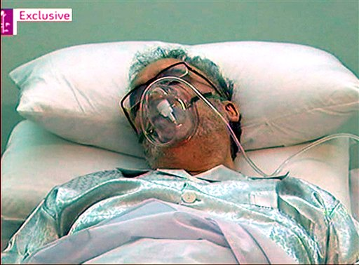 Released Lockerbie bomber Abdel Baset al-Megrahi, is seen in a hospital bed in Tripoli Sunday Aug. 30, 2009. Libyan Secretary of State for Foreign Affairs, Mohammed Siala, said Monday Aug. 31, 2009  that Abdel Baset al-Megrahi was in the hospital and described him as a dying man