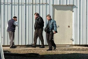 Government representatives, one of whom said he was from the United States Department of Agricultures compliance unit were at 6260 Kinsman Road in Kinsman on Monday after a reported FBI raid on a meat processing facility.  (Liz Wilkinson Allen/Staff Photographer)