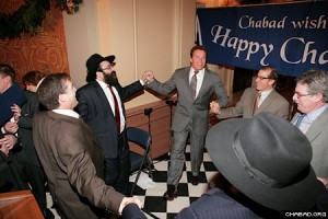 The governor participates in a Chasidic dance during the Chanukah celebration.