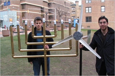 Raffi Holzer, left, and Mark Stauber with their invention. It took a while to find the right spot for the turbine.Matthew [Yaniv/Yeshiva University ]
