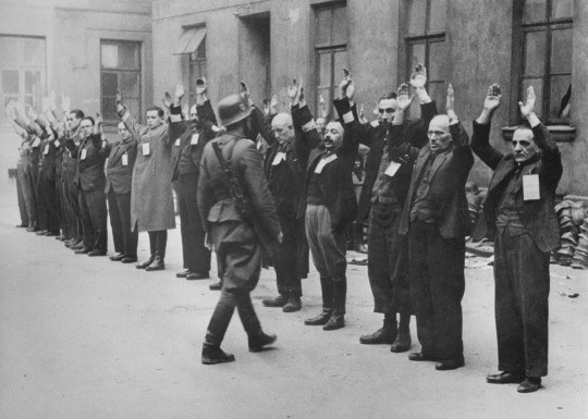 A Nazi soldier inspects a group of Jewish workers in the Warsaw Ghetto in April 1943. AFP