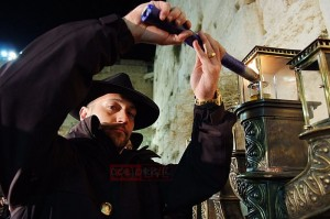 Guma Aguiar this past Chanukah lighting Menorah in Israel with Chabad [Photo: COL]