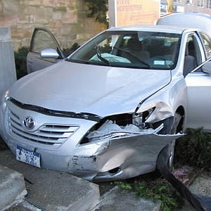 The 2009 Toyota Camry careered into a Queens building yesterday. Photo: NY Post