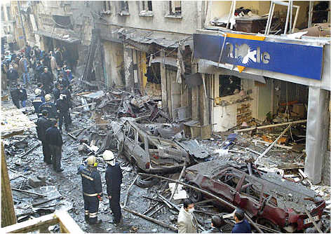 in 2003 Turkish police officers examine the scene in front of the Neve Shalom Synagogue car bomb attack. Neve Shalom was crowded for a bar mitsvah celebration. (AP)