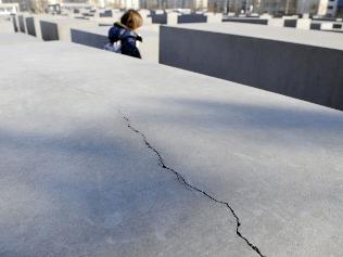 A long crack runs across one of the concrete slabs of the Holocaust Memorial for the Murdered Jews of Europe in Berlin
