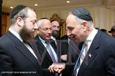 Ezra Friedlander, CEO of The Friedlander Group talking to Schumer