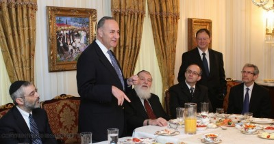 Sen. Schumer at Abe Biderman's home in Borough Park (L-R) Rabbi Chaim Dovid Zwiebel, Rabbi Nosen Sherman, [standing] Abe Biderman
