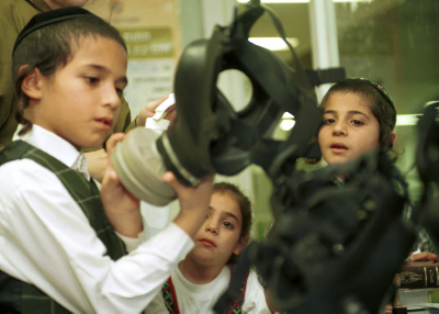 FILE - Young ultra orthodox boys learn how to use a gasmask during the days of the Second Intifada. October 30, 2001.