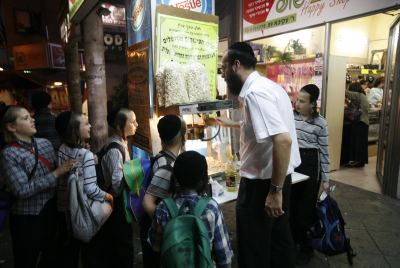 FILE - Ultra orthodox jewish boys buy popcorn at a street stand in Bnei Brak.  Photo by Miriam Alster/Flash90