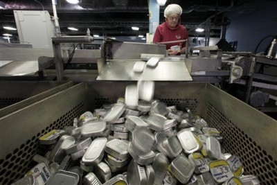 In this Thursday, April 8, 2010 photo, a worker inspects cans at the Stinson sardine cannery in Gouldsboro, Maine. The sardine cannery, the last one operating in the U.S., will shut down this week. (AP Photo/Robert F. Bukaty)