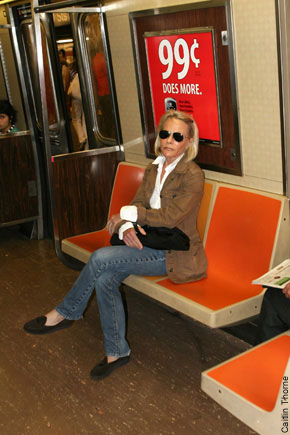 FILE 2009 - Ruth Madoof, the millionaire wife of Bernard Madoff, is seen here riding the F train beneath an ad promoting a 99/c cellphone bargain.