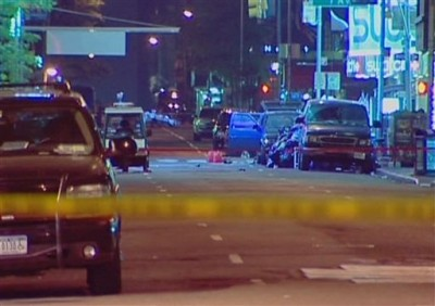 In this image taken from video, the vehicle containing a car bomb, stands with the door open and red canisters on the roadway at New York's Times Square, NY, U.S.A., Sunday, May 2, 2010. Police cleared the streets around Times Square when the vehicle was seen to be smoking late Saturday evening, before recovering un-detonated bomb components including cans of gasoline, tanks of propane, fireworks and other electrical equipment from the sport utility vehicle.(AP Photo/APTV)