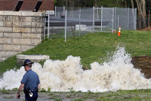 Water surges from the ground at the site of a water main break, Saturday, May 1, 2010, in Weston, Mass. Water to 2 million people in Boston and more than two dozen suburbs is temporarily unsuitable for drinking after the break in a pipe that connects a major suburban reservoir to the city. (AP Photo/Michael Dwyer)