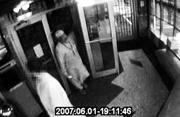 FILE - Video frame grabs of Russell Defreitas, in a traditional Muslim outfit and skullcap, caught on the surveillance tape of the Lindenwood Diner with an FBI informant, face pixelated, Monday, June 4, 2007. Defreitas is one of four men arrested in the JFK Airport terror plot. Charles Eckert / Polaris