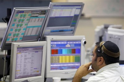FILE - A trader works in the dealing room of the First International Bank of Israel (FIBI) in Tel Aviv October 7, 2008 According to a new ruling by the Badatz Utra-Orthodox Jews must not invest in the shares of Israeli companies Photo: Reuters