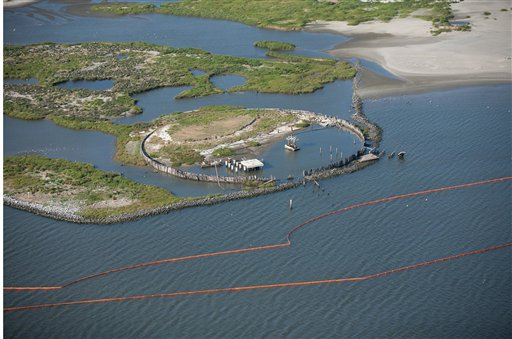 This image provided by the U.S. Coast Guard shows a containment boom staged at the Breton National Wildlife Refuge, Thursday, April 29, 2010. The spill _ a slick more than 130 miles long and 70 miles wide _ threatens hundreds of species of wildlife, including birds, dolphins and the fish, shrimp, oysters and crabs that make the Gulf Coast one of the nation's most abundant sources of seafood.  (AP Photo/US Coast Guard)