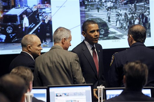 President Barack Obama meets New York City police officers in their Real Time Crime Center at police headquarters in New York City, Thursday, May 13, 2010 with photos from the attempted Times Square bombing on the screen. New York City Police Commissioner Ray Kelly stands at left. (AP Photo/Susan Walsh)