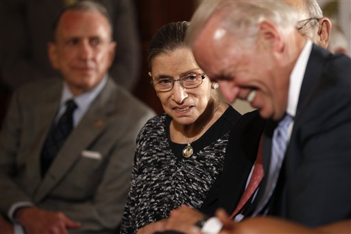 Supreme Court justice Ruth Bader Ginsburg, center, sits with Vice President Joe Biden, right, and Sen. Arlen Specter, D-Pa., as President Barack Obama and first lady Michelle Obama hold an event honoring Jewish American Heritage Month in the East Room of the White House in Washington, Thursday, May 27, 2010. (AP Photo/Charles Dharapak)