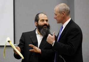 Sholom Rubashkin, left, talks with Defense Attorney F. Montgomery Brown during a break following open statements of the child labor changers trial at the Black Hawk County Courthouse on May, 10, 2010, in Waterloo, Iowa. (Rick Tibbott)