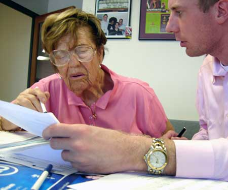 FILE - Holocaust survivor Rosalie Greenfield fills out claims for reparations from the Hungarian government during a summer 2006 clinic run by Bet Tzedek.