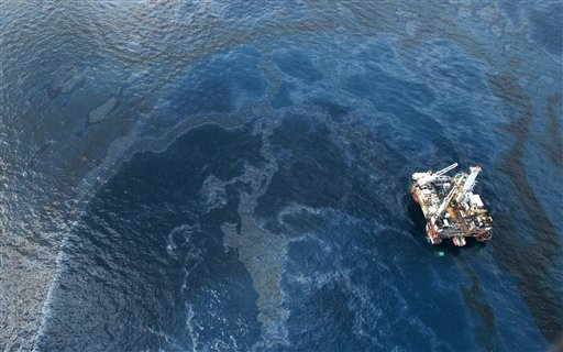 Oil surrounds the site of the Deepwater Horizon oil spill in the Gulf of Mexico near the coast of Louisiana, Monday, May 31, 2010. (AP Photo/Jae C. Hong)