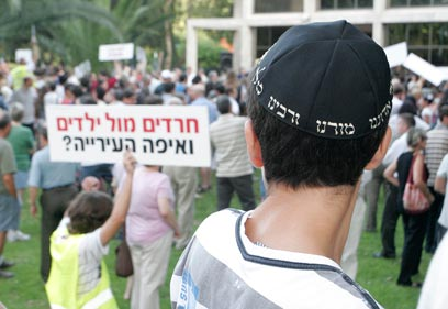Religious boy observes a secular rally June 7 2010 in front of Chabad house at Ramat Aviv(Photo: Amir Levy)