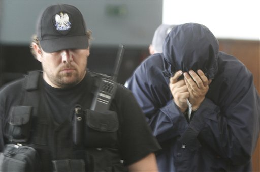 Hiding his face, Israeli citizen Uri Brodsky is escorted by anti-terrorists to a court session in Warsaw, Poland, on Monday July 5, 2010. The court is to decide whether Brodsky, an alleged Mossad agent, should be extradited to Germany on a European Arrest Warrant in connection to a Hamas leader's slaying. (AP Photo/Czarek Sokolowski)