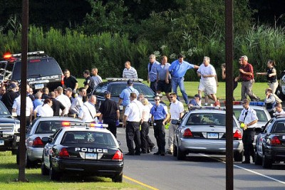 People are seen being evacuated from Hartford Distributors, Inc., in Manchester, Conn. Authorities say several people have been shot at the beer distribution company in Connecticut. (Hill/AP)