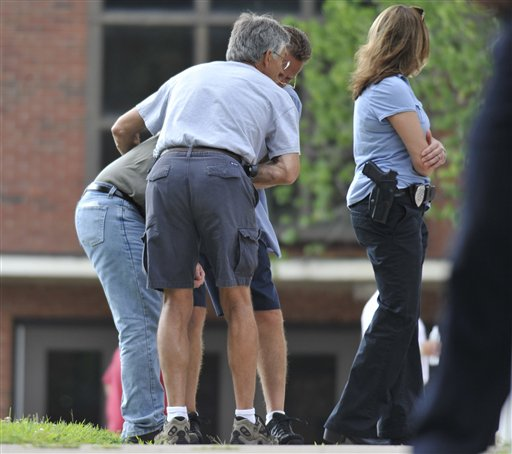 Workers and family of workers from Hartford Distributors gather at Manchester High School in Manchester, Conn., Tuesday, Aug. 3, 2010. Authorities say several people have been shot at the beer distribution company in Connecticut. (AP Photo/Jessica Hill)